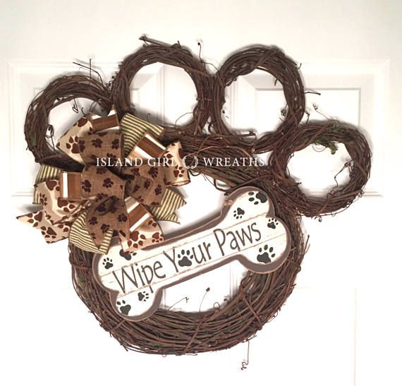 This paw shape grapevine wreath is about 20 in length and about 20 wide by the toes. This wreath is made using different sizes grapevine wreaths, a multi layer bow made from wired ribbons and a wipe your paws wood sign which is securely attached to the wreath using wire and hot glue. Note: No two grapevine wreaths are identical so the wreath you purchase could be slightly different in shape and in color but will still be in the shape of a paw.