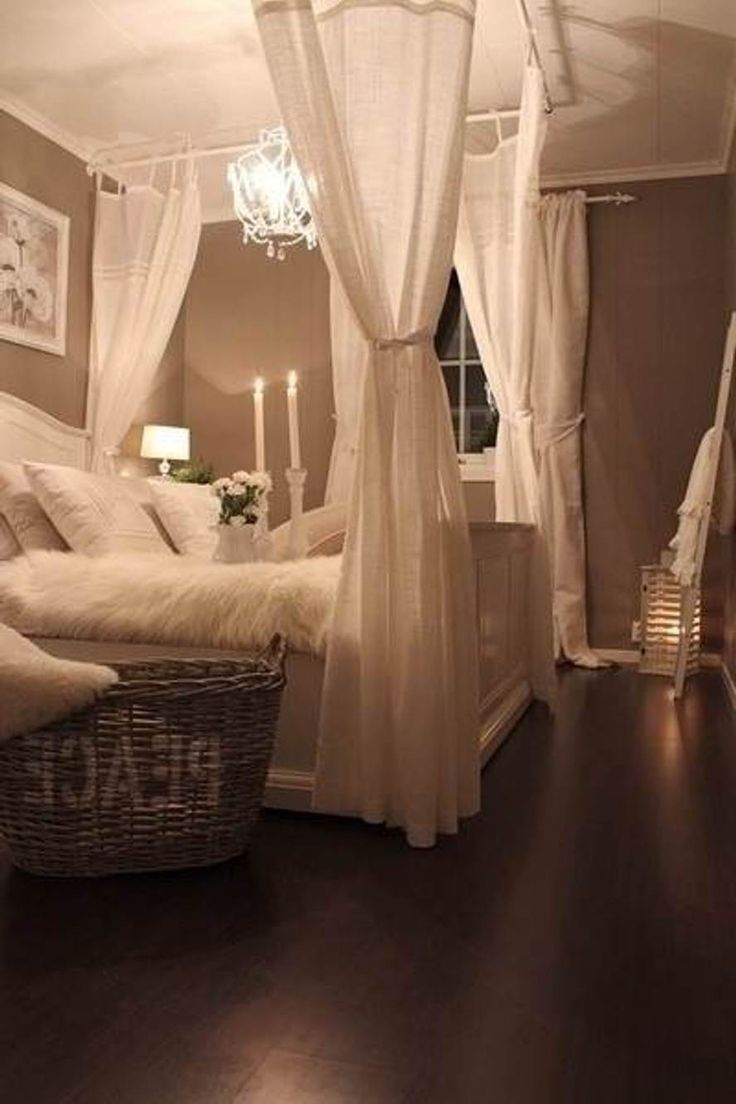 Easy and inexpensive ways to put a little romance in your room. White Christmas lights, drapes for drama on four corners of the bed. Again muted tones create a peaceful environment. #bedroom #inspiration #vlgcommunities