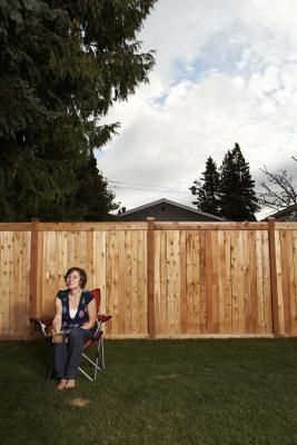 A chain-link fence may be utilitarian, but it isn't the classiest type of fence. It can be converted to a wood fence, however. One of the advantages of chain-link fence posts is that they are ...