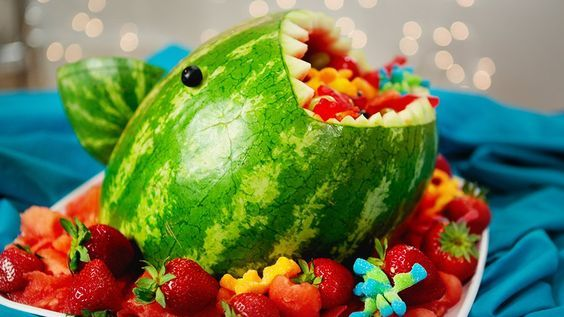 This Watermelon Shark Will Make Your Jaw Drop: Whether you make this for a Sharknado 4 viewing party, Shark Week, or a kid's birthday, there's no question guests will get a major kick out of this watermelon shark.