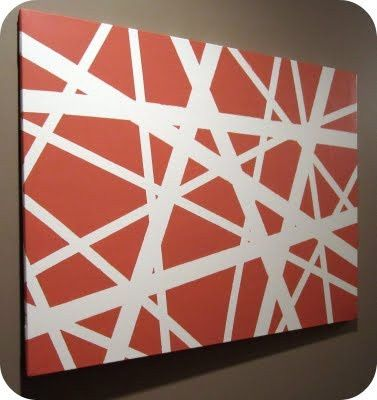 Cover your canvas in painter's tape before you paint it—you could do random lines, a design, image, or word! Looks awesome when you pull the tape off!