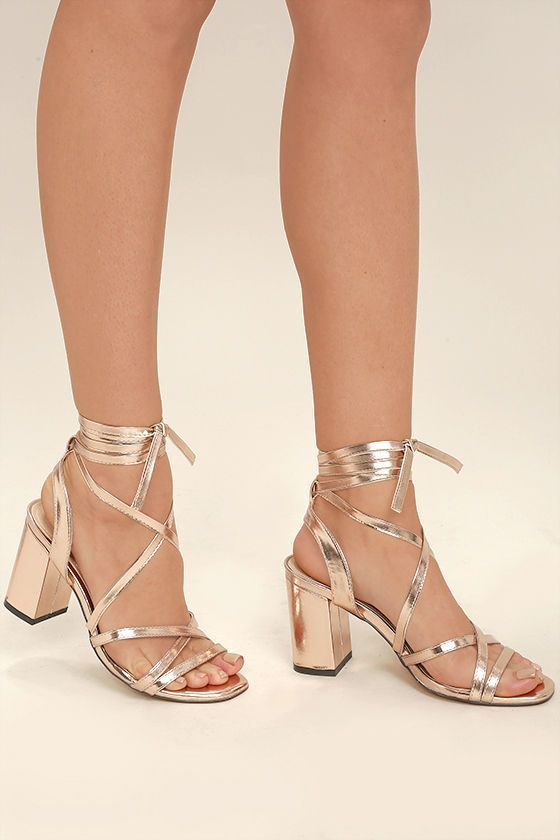 The only heels that can take your look from great to gorgeous are the Oni Rose Gold Lace-Up Heels! Vegan leather straps cross and climb from a squared-off, peep-toe upper, to tie elegantly around the leg.