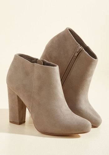 Turn hours of chic daydreaming into reality by incorporating these taupe booties into your footwear rotation! Easily recreating the strut of your most confident fantasies with their high heels and faux-suede finish, these minimalist kicks will help you achieve the style that's always on your mind.