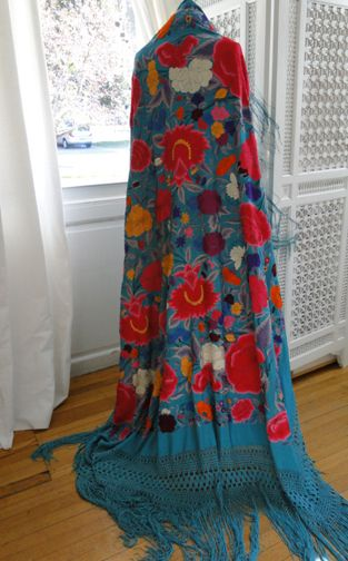 Superb Turquoise Silk Canton Shawl Circa late 1800's-early 1900, this wonderful large silk canton shawl is truly vibrant. The turquoise silk in enhanced with spectacular large and colorful flowers. A dramatic and beautiful shawl.