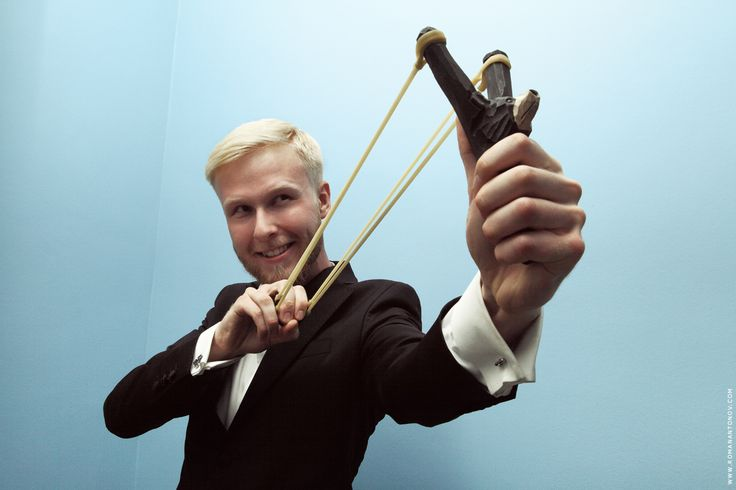 Portrait of man with slingshot