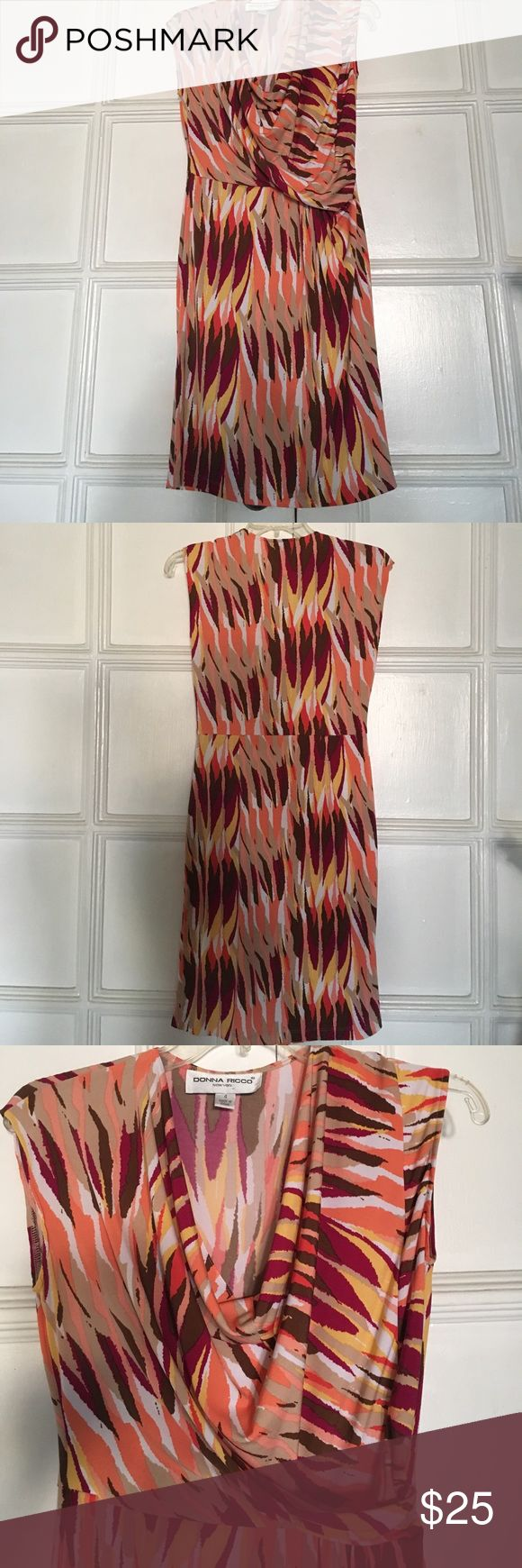 Donna Ricco cowl neck sleeveless multicolor dress Donna Ricco cowl neck sleeveless multicolor dress size 4 rich beautiful colors; gold purple orange brown coral. Very comfortable great for any occasion especially for travel. Wear with heels or flats 96% polyester 4 % spandex. Donna Ricco Dresses Midi