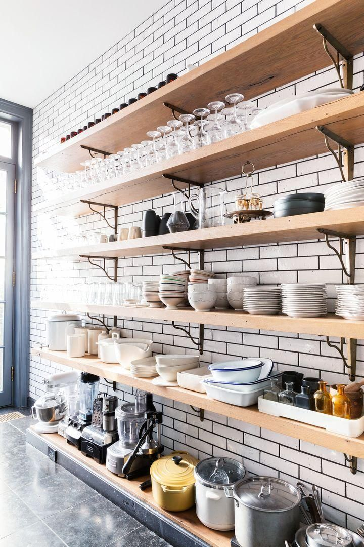 What kitchen dreams are made of: open shelving remodel, with rustic ceramics, high ceilings and white subway tiles.