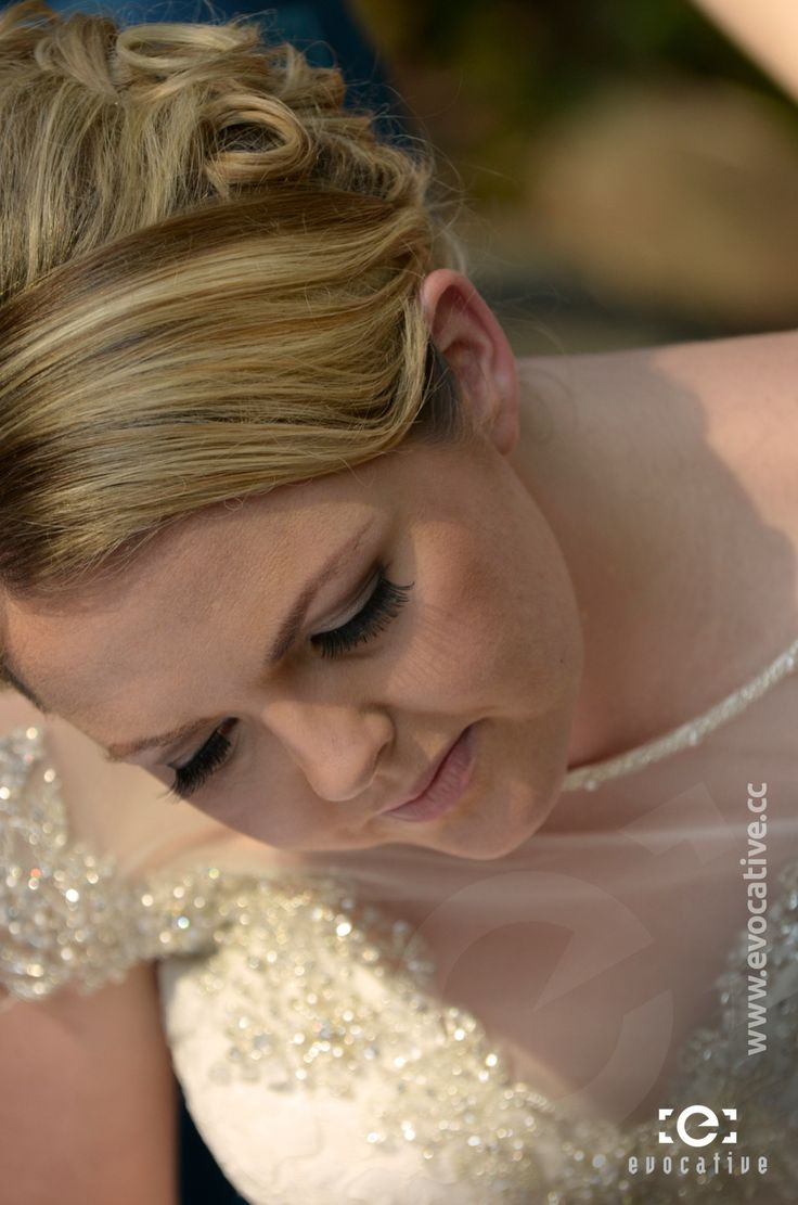 Detail of the bride's hair, makeup and dress while she signs the marriage certificate, at Woodlands of Marburg. #WeddingPhotography