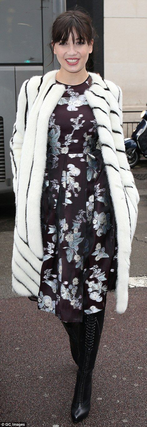 One print just won't do: Daisy Lowe changed out of the muted look she sported earlier on in the day and into a floral-printed dress and a striped fur coat