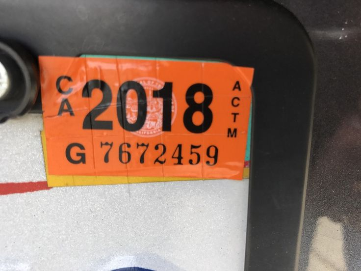 After installing car registration sticker, score it with a razor blade to prevent thieves from stealing it