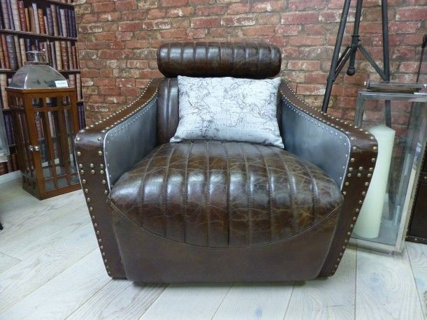 Aviation leather armchairs. Finished in aluminium metal with distressed brown Italian leather detailing. Unique vintage chairs from smithers of stamford aviator furniture range