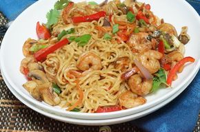 """You all already know that I have an undying love for indomie noodies. Here is a simple """"fancy"""" indomie recipe to add to your arsenal  Ingredients:  1 packet indomie noodles 1 cup raw shrimp (cleaned) 1 tablespoon cooking oil Vegetables of Choice - Chopped- 1 cup plus  Direction:  Remove seasoning from"""