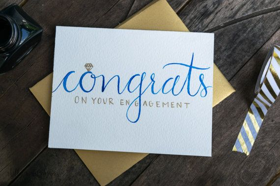 This is an original, hand-painted watercolor engagement card. Its created with gold calligraphy ink, and the Congrats color can always be