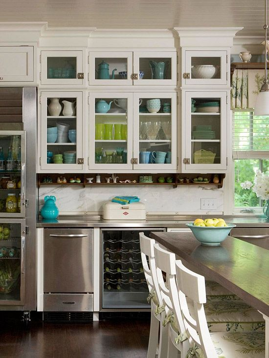 colorful dishes in white glass front cabinets