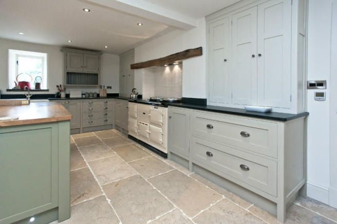 Love the colour floor tiles with the cabinetry
