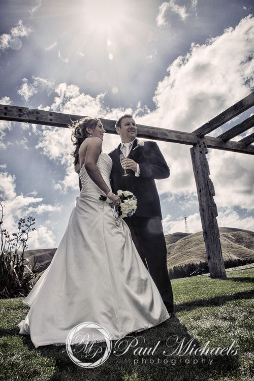 Celebrating with a wine at Ohariu farm. Wellington weddings by PaulMichaels photography http://www.paulmichaels.co.nz/bede-dawn-wedding/