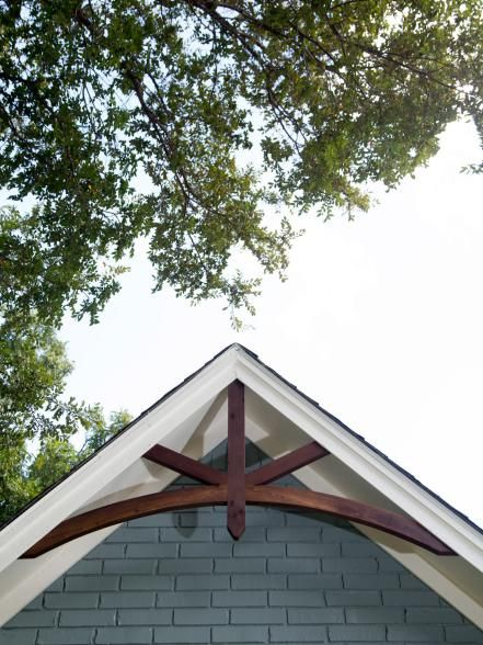 A new highlight of the home's front exterior is the decorative wood accents under the peaks of the roofline.
