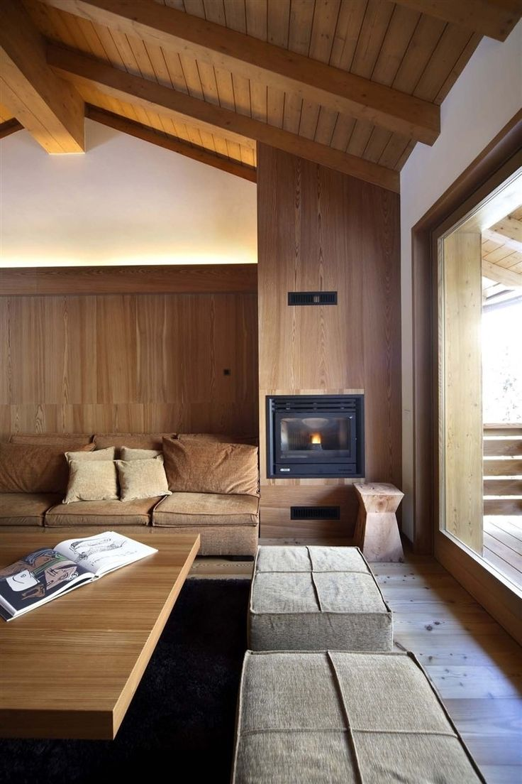 Interesting warm wooden interior design by Gianluca Fanetti. This apartment finished in 2010 is situated in Campodolcino, Italy, close to the border with Switzerland. Enjoy!