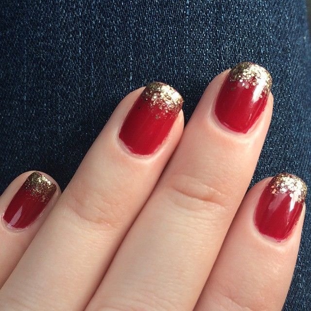 red nails with gold glitter tips perfect for the holidays