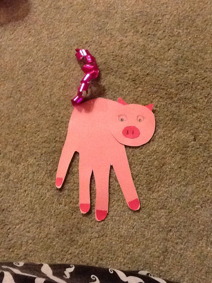 Handprint pigs made for EYFS. Great for a Three Little Pigs