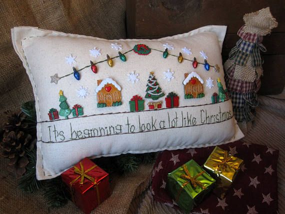 This hand-made muslin needlework pillow celebrates the excitement of the Christmas season. Get ready for that snow! Size is approximately 14-1/2 x 8.