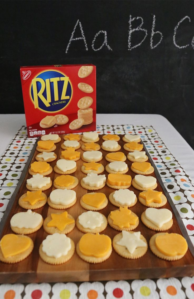 RITZ Crackers topped with cute cheese shapes are a tasty after-school snack for your kids. [Sp]