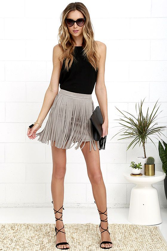 Shimmy your way into everyone's hearts in the BB Dakota Pearl Taupe Suede Fringe Mini Skirt! Super soft and stretchy microfiber suede begins at a high, banded waist while all-around fringe adorns the sexy bodycon mini skirt. Hidden back zipper with clasp.