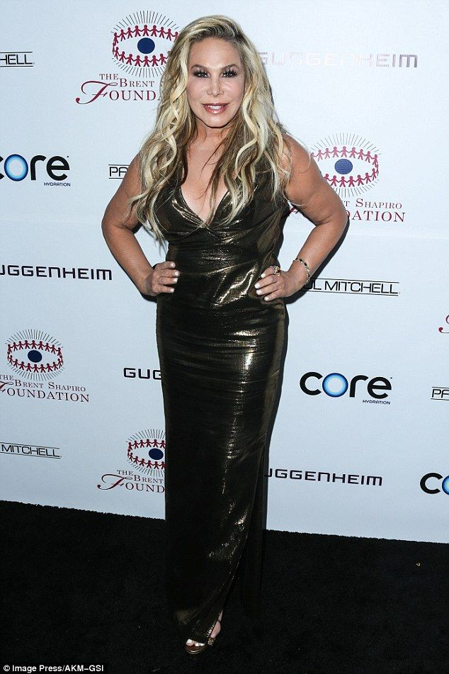 Risk-taker: Adrienne Maloof, 55, wore a metallic, V-neck gown, which was the…