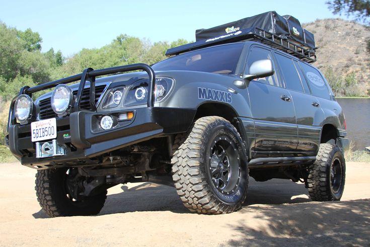 "1998 Lexus LX470, Ironman Bumper & Suspension Lift, Baja Rack, Demello Sliders, 33"" Maxxis Tires , Fuel 17"" Wheels, Digital Designs Sound System with Jensen In Dash Nav and Headrest Monitors"