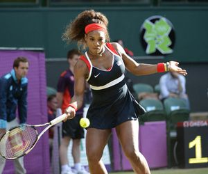 Aug 3, 2012; London, United Kingdom; Serena Williams (USA) hits during the match. Williams defeated Victoria Azarenka (BLR) 6-0, 6-3 to advance to the finals in the London 2012 Olympic Games at Wimbledon. Mandatory Credit: Bob Donnan-USA TODAY Sports