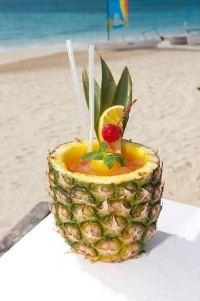 From Cuisinart Resort & Spa, Anguilla - This cocktail is best enjoyed at the resort's Azure Beach Bar, served by friendly bartender Sam—a beach bar staple. The cocktail, served in a hollow pineapple, is a combination of Pyrat Pistol rum, Galliano, apricot brandy, and tropical juices.
