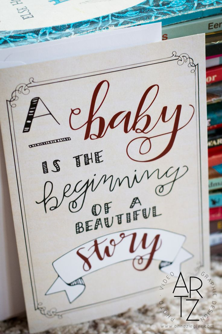 A Baby is the Beginning of a Beautiful Story: front of book-themed baby shower invitation