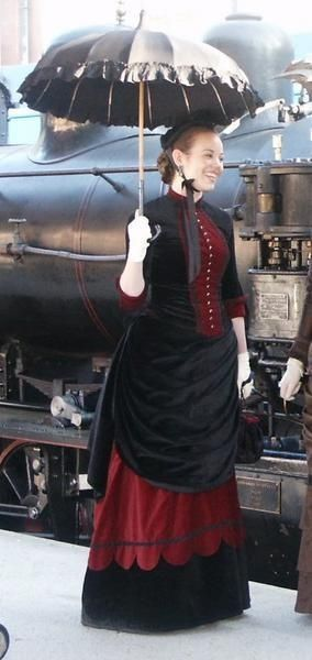 Great base ensemble. Kick up the Steamer Style by hanging little gears from the umbrella, or weaving a gold watch fob into the corset. Pin up the front of the underskirt, and show off those Victorian boots. Color-shock with ribbons, and makeup in surprising hues. Use your imagination!