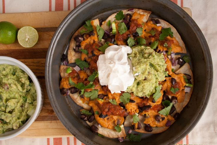 Loaded Vegan Nachos (vegan, gluten free) - This recipe has all homemade ingredients: guacamole,salsa, nacho cheese, sour cream, and baked chips!