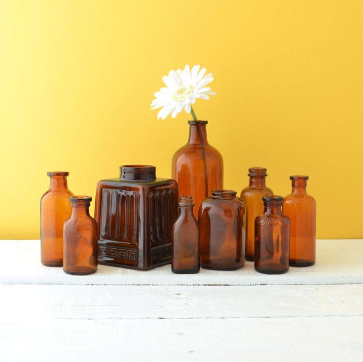 Antique Brown Glass Bottles - Amber Glass Bottles - Vintage Bottles - Instant Collection - Rustic Wedding Decoration - Set of 9. $58.00, via Etsy.