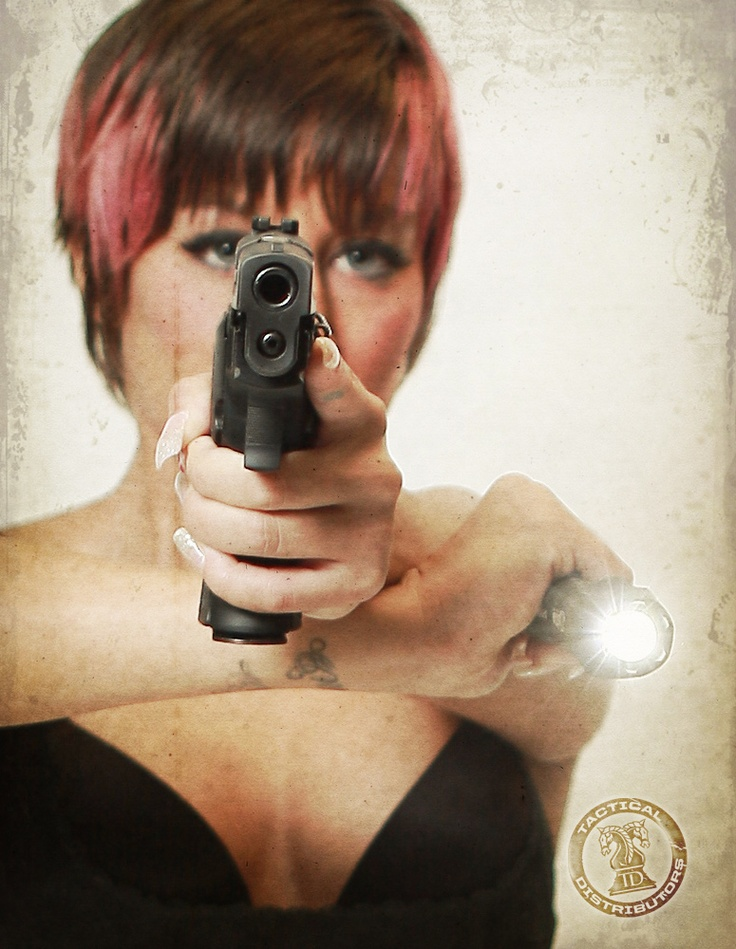 Gear Girl with a Sig Sauer p226 and Elzetta flash light.