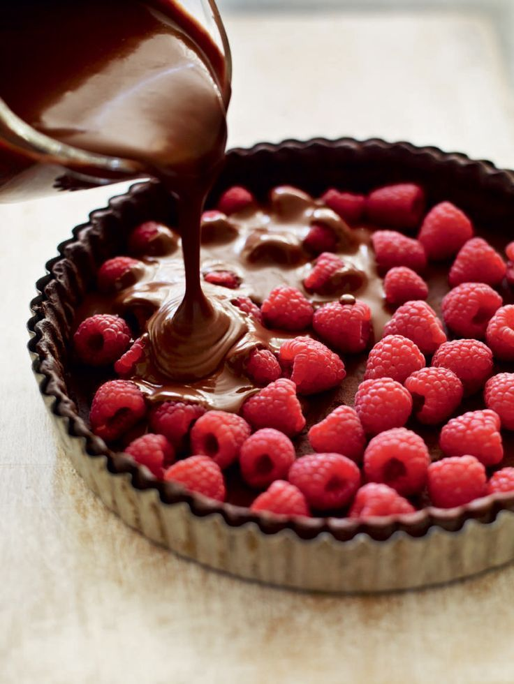 This tart is very rich, so it goes a long way. Serve with some more fresh raspberries on the side and a little extra cream if you can't resist.
