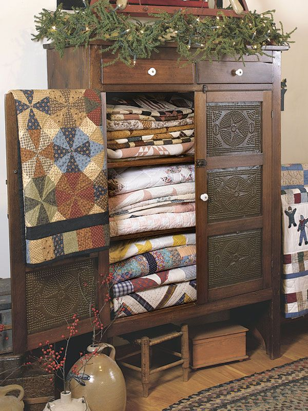 Old Pie Safe...filled with prim quilts. Country Sampler's 30 Icons of Country Style: Quilts.