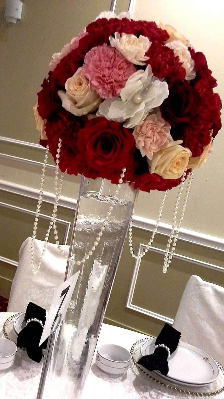 rose and carnation ball centerpiece with hanging pearls; design by Davis Floral Creations