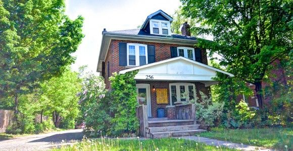 Fantastic Edwardian-Era Arts  Crafts home and business right on Broadway Ave! Hipped roof and dormer window in the finished attic, large covered front porch, and balanced facade, typical of the Edwardian era.