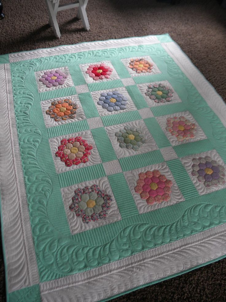 hexagon-Love the quilting on this. I wish I could give credit where credit is due.