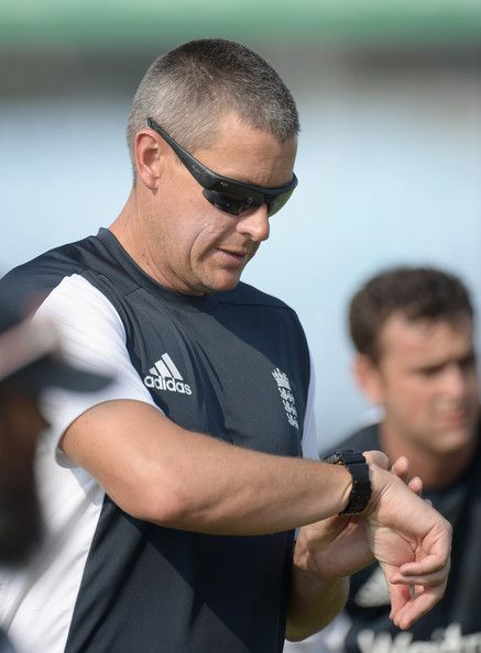 Ashley Giles Photos Photos - England coach Ashley Giles looks at his watch during a nets session at Jahur Ahmed Chowdhury Stadium on March 21, 2014 in Chittagong, Bangladesh. - England Nets Session