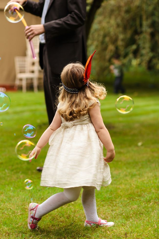 English garden party wedding - blowing bubbles. #wedding #bubbles Image: Bohemian Weddings