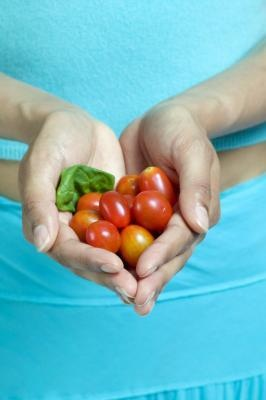 """""""Like many fruits and vegetables, cherry tomatoes are nutrient-dense, meaning they contain a minimal amount of calories, while providing numerous vitamins and minerals. One cup of cherry tomatoes that weighs 149 grams supplies your body with just 27 calories. The single-cup serving also provides 1.31 grams of protein, .30 grams of fat and 5.8 grams of carbohydrates, as well as 353 milligrams of potassium, 16 milligrams of magnesium, 36 milligrams of phosphorus..."""""""