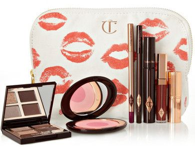 Charlotte Tilbury - The Vintage Vamp - this glamorous look combines Art Deco elegance with something a little more modern and soulful. With sultry eyes and a wine-stained pout, this set contrasts berry tones with touches of gold - perfect for parties and events