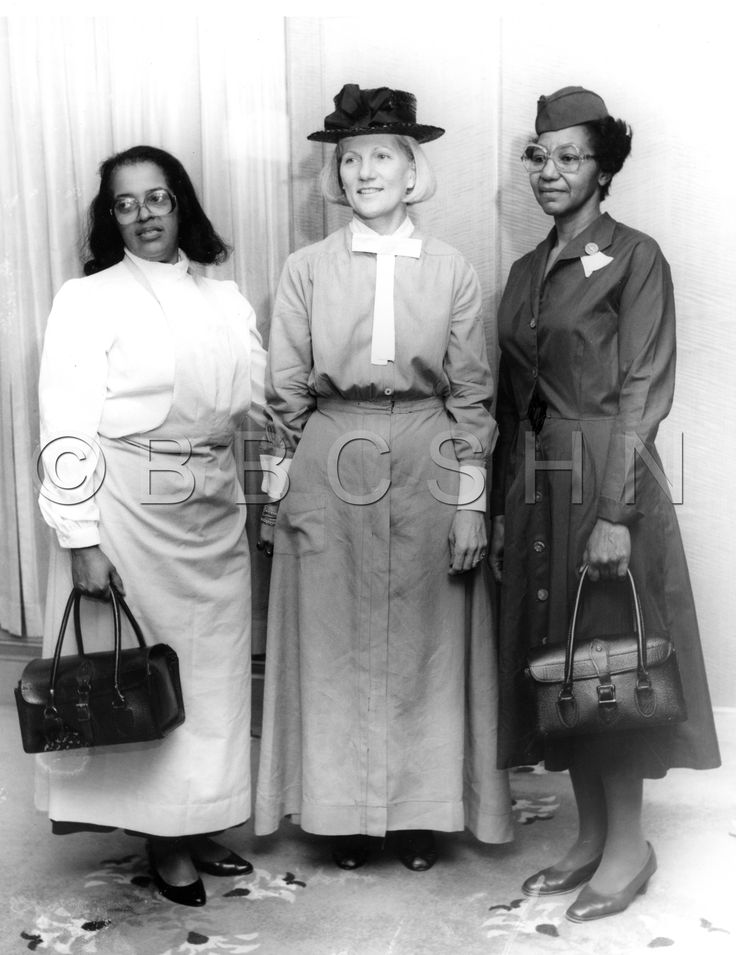 Three nurses wearing dresses nurses uniforms from different eras pose at the 100th anniversary celebration of the  Visiting Nurse Society of Philadelphia, 1986. Image courtesy of the Barbara Bates Center for the Study of the History of Nursing.