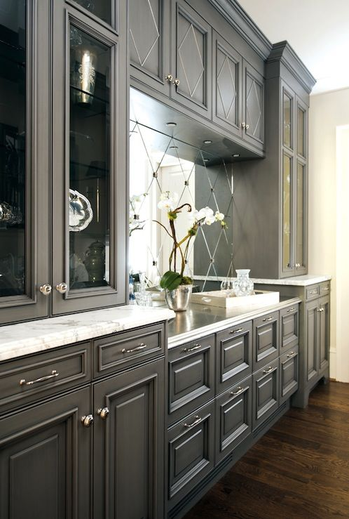#Atlanta Homes & Lifestyles: Beautiful gray kitchen design with charcoal gray kitchen cabinets, calcutta marble ...I am luving this!!!! that backsplash rocks.