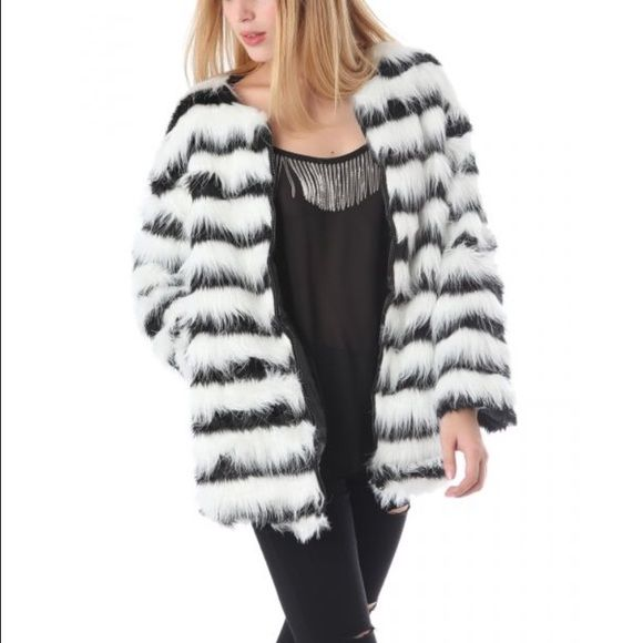 Faux Fur Jacket Black and white striped design faux fur jacket. Two side pockets and zip fastening. Jackets & Coats