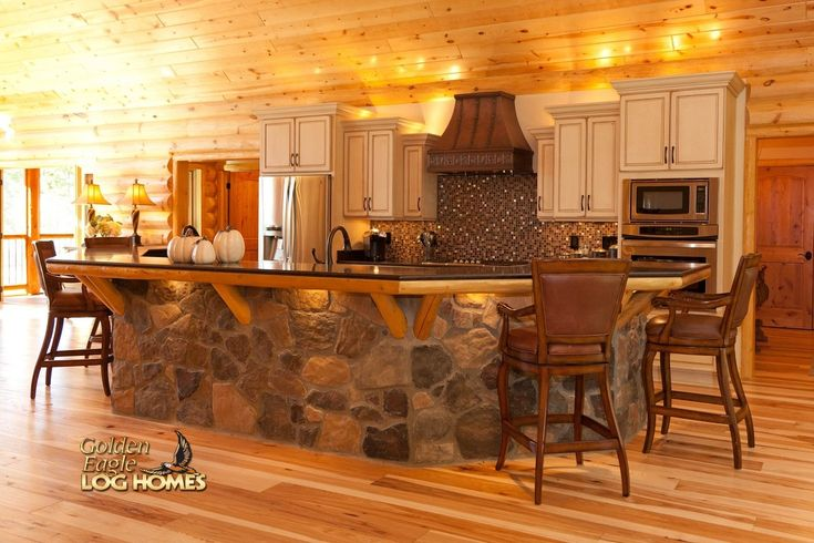 Log Home By Golden Eagle Log Homes - Island Kitchen Stone Wood Flooring Interior