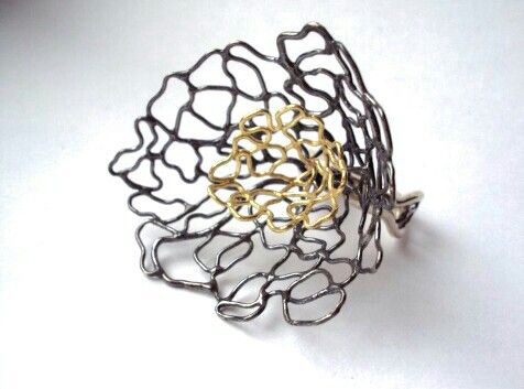 Gold and silver ring by maxine di vico